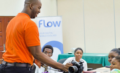 BrightPath facilitator Juma Bannister, left, leads eager young participants in a hands-on Digital Photography session at BrightPath's TechLink Barbados workshop, Cave Hill School of Business, June 21. Photo courtesy The BrightPath Foundation.